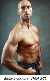muscular man posing showing his biceps