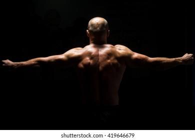 Muscular Man Praying - Spiritual Concentration Concept - Back View