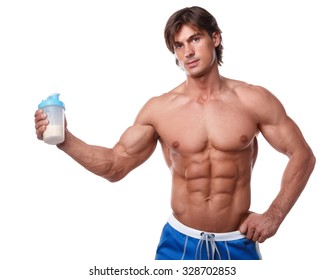 Muscular man with protein drink in shaker over white background