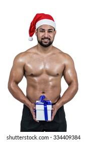 Muscular man in santa hat on white background