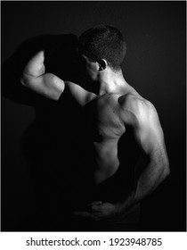 a muscular man with shadows