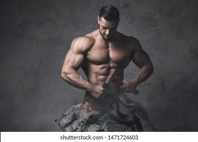 Muscular man statue. Bodybuilder made himself from the piece of stone. Concept of self improvement and bodybuilding progress.