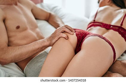 The muscular man touching buttocks of his woman