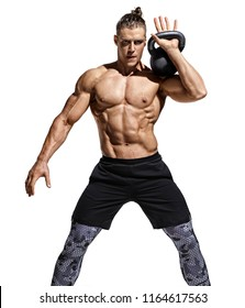 Muscular man training with kettlebell. Photo of handsome man with naked torso and good physique on white background. Strength and motivation