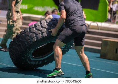 Muscular Man Training: Soldiers Lift Huge and Heavy Truck Tire