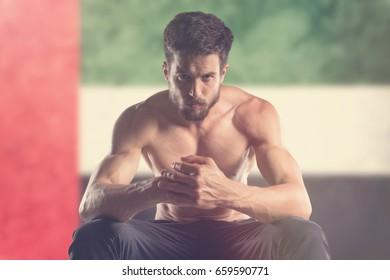 Muscular man with UAE Flag behind
