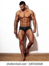 Muscular man in underwear on white.