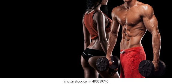 muscular man and woman standing with hands