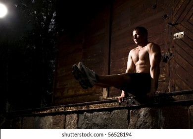 muscular man and wooden background