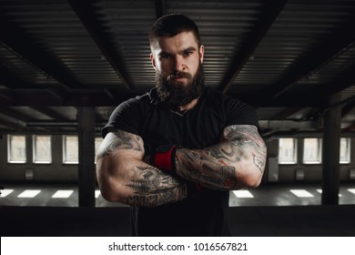 Muscular man working out at gym