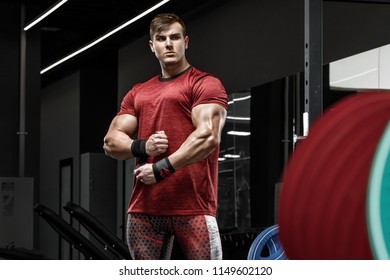 Muscular man working out in gym, strong bodybuilder male