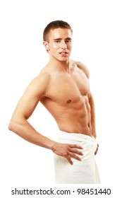 muscular man wrapped a white towel isolated on white background