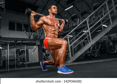 Muscular Men Doing Barbell Lunges at the Gym