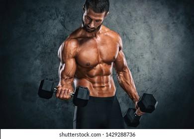 Muscular Men Lifting Weights. Studio Shot