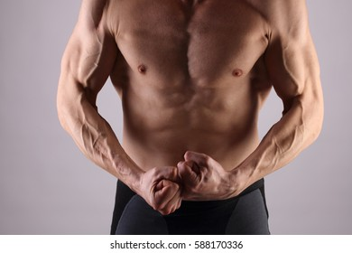Muscular Men, perfect body, abs, six pack. Strong athletic guy showing his torso. Bodybuilding, sport, fitness ,workout, active lifestyle, hair removal,male waxing concept.
