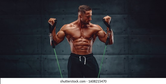 Muscular Men Training With Resistance Bands. Copy Space