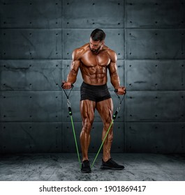 Muscular Men Training With Resistance Bands