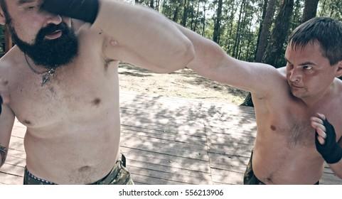 Muscular men wrestling. Muscular fighter.