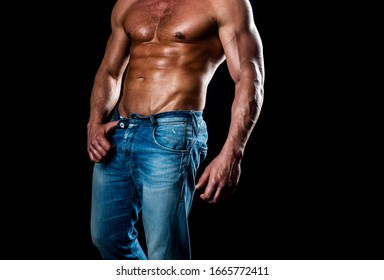 Muscular model sports young man on dark background. Athletic man with ab, abs or six pack. Chest muscles. Male torso