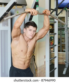 muscular perfect male in gym centre