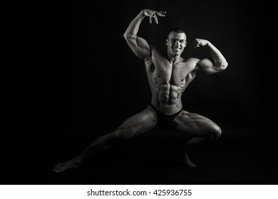 Muscular, relief bodybuilder on a black background