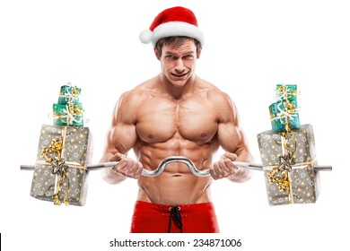 Muscular Santa Claus doing exercises with gifts isolated over white background