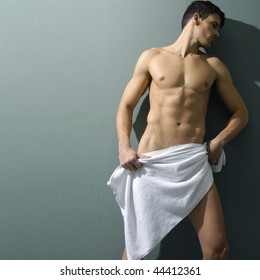 muscular sexy man covered with the towel