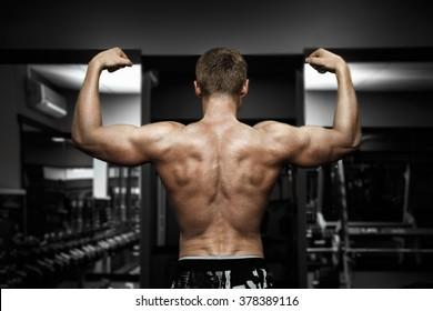muscular super-high level handsome man posing on black background