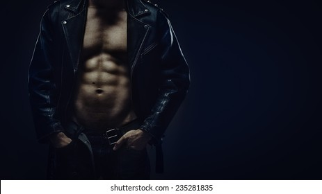 Muscular torso of athletic man in leather jacket