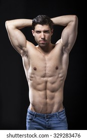 muscular torso of man on black background