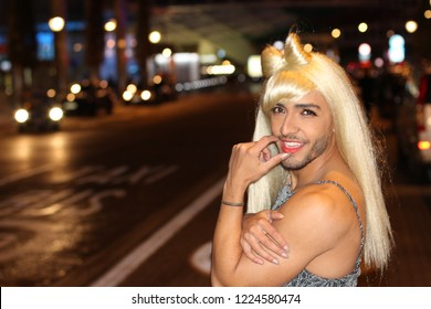 Muscular transvestite with beard and blonde wig