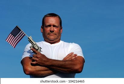 Muscular White Man Holding An American Flag And Gun, symbolizing our constitutional right to own and bear arms