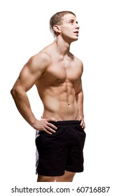 Muscular young male on white background