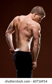 Muscular young male showing his back muscles