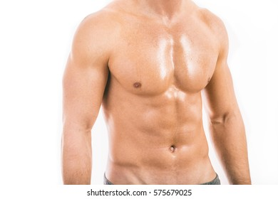 Muscular young man isolated on white background.