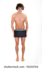 Muscular young man with laptop