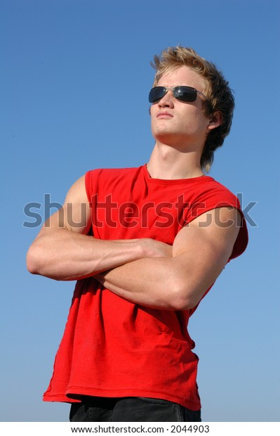 Muscular young man in a red tank top