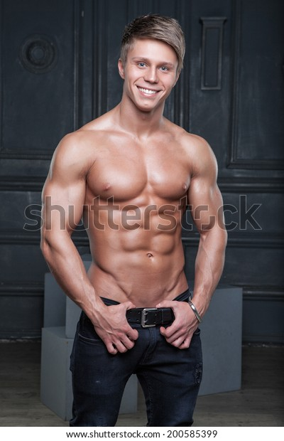 Muscular Young Naked Guy Posing In Jeans And Shoes Stock