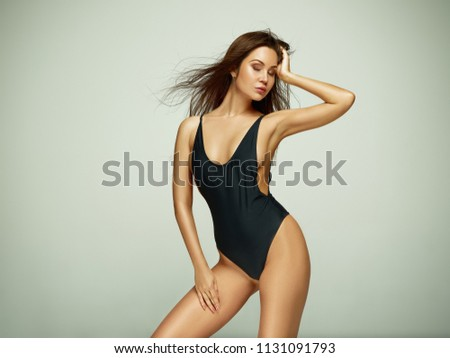 adfced9037 ... young woman or female athlete posing at studio on gray background. Fit  caucasian model with perfect body. Fitness