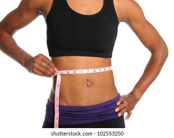 Muscular young woman measuring waist with tape isolated over white background