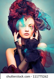 Muse. Romantic portrait of young woman with bright creative make-up in fantastic hat
