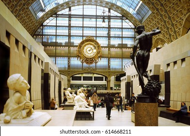 Musee d'Orsay, Paris 2014. View from the central corridor, in the background the clock of the old railway station,on the right the David of Antonin Mercié seen from behind.