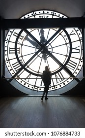 Musee d'Orsay, Paris, France. Feb 2018. Girl silhouette standing in front of the clock tower of Orsay Museum.