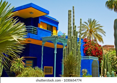 THE MUSEUM BUILDING AND GARDEN, JARDIN JACQUES MAJORELLE, MARRAKECH, MOROCCO. MAY 2O12. The colourful modern decoration of the museum building with planted containers and plants in the garden.