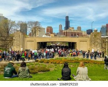 MUSEUM CAMPUS, CHICAGO-April 22, 2017. March for Science. Demonstrators enter Museum Campus via the Lake Shore Drive pedway and head toward the rally. A great view of the skyline and Lake Shore Drive.