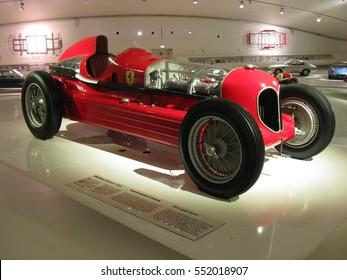MUSEUM CASA ENZO FERRARI, MODENA / ITALY on JULY 2014: Red sport luxury old car ALFA ROMEO 16C Bimotore serie produced from 1935 on exhibition in salon room, overview, Europe.