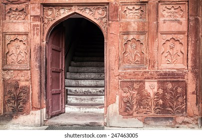 Museum entrance with carved walls in Red Fort, Old Delhi, India