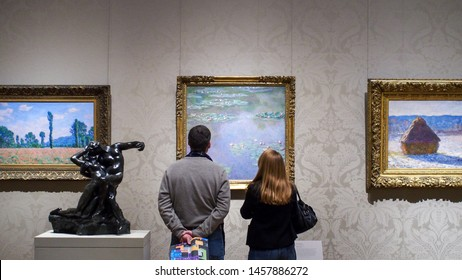 The Museum of Fine Arts, Boston, Massachusetts, United States of America - Jan 09 2015: Vistiors looking at art works of Claude Monet, a founder of French Impressionist painting. Impressionism. Couple