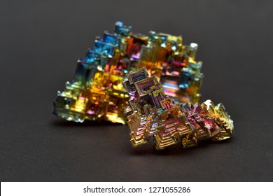 MUSEUM MINERAL SERIES: Bismuth crystals on a dark background. This is the most strongly diamagnetic element and also the heaviest that is not radioactive.
