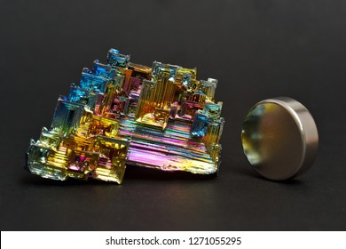 MUSEUM MINERAL SERIES: Bismuth crystals and a neodymium magnet. Bismuth is the most strongly diamagnetic element and also the heaviest that is not radioactive.